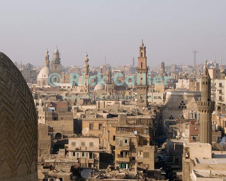 Skyline -- Cairo, Egypt.  Minarets dot the skyline in the oldest, walled city at the center of Islamic Cairo.  Dominating the left is the dome of the Mosque of al-Muayyad. © Rick Collier<br /> <br /> <br /> <br /> <br /> <br /> <br /> Egypt Egyptian Cairo tourist tourism history historic antiquities Islamic old street shop window building city wall arch 'city gate' Zwayla 'Bab Zwayla' minaret dome mosque skyline cityscape 'old town' 'walled city' al-Muayyad