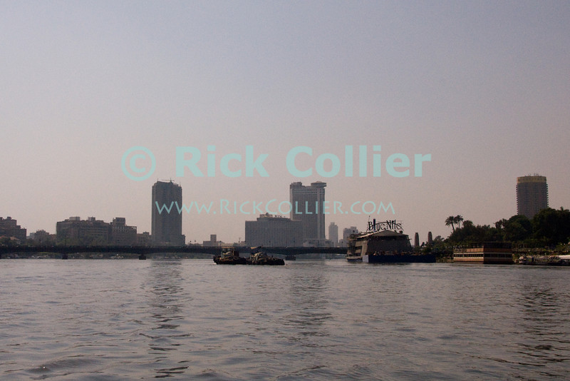 "Cairo, Egypt -- Nile River cruise.  Cairo looks very different form a boat in the Nile River. © Rick Collier / RickCollier.com.<br /> <br /> <br /> <br /> <br /> <br /> travel; vacation; tour; tourism; tourist; destination; Egypt; Cairo; city; view; Nile; River; ""Nile River""; cruise; buildings; shoreline; boat; boats; bridge; bridges; hotels;"