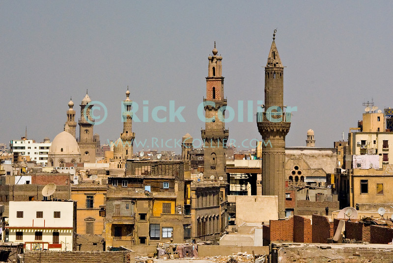 """Cairo, Egypt -- View from the minarets of the Bab Zuwayla gate.  One of the three first gates installed around the historic walled city of Cairo, standing at the southern boundary of old Fatimid Cairo.  The two minarets atop this tower actually belong to the nearby Mosque of al-Mu'ayyad, which sits just inside this gate.  For a small fee, it is possible to climb the minarets for a spectacular view of old and new Cairo, featuring many minarets above the old city. © Rick Collier / RickCollier.com.<br /> <br /> <br /> <br /> <br /> <br /> travel; vacation; tour; tourism; tourist; destination; Egypt; Cairo; city; view; gate; walls; bab; """"Bab Zuwayla""""; Zuwayla; minaret; Fatimid; Fatmid; """"city gate""""; """"Islamic Cairo"""";"""