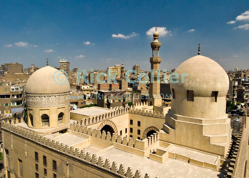 """Cairo, Egypt -- A working mosque (close foreground) stands directly adjoining and dominates the view of Cairo when viewed from this side of the minaret of the historic ibn Tulun mosque. © Rick Collier / RickCollier.com.<br /> <br /> <br /> <br /> <br /> <br /> travel; vacation; tour; tourism; tourist; destination; Egypt; Cairo; mosque; madrassa; Tulun; """"ibn Tulun""""; citadel; Saladin; Hassan; """"Sultan Hassan""""; skyline; panorama; view;"""