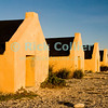 "Bonaire, Netherland Antilles -- Slave huts at one of the several salt stations in the south of Bonaire (Orange Pan).   © Rick Collier<br /> <br /> <br /> <br /> <br /> Bonaire; ""Netherlands Antilles""; Caribbean; tropic; tropical; vacation; destination; salt; anchorage; ""salt pan""; slave; ""slave hut""; ""slave quarters""; house; marker; orange; ""Orange Pan""; ""Orangepan""; seashore; ocean; sea; view;"