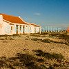 "Bonaire, Netherland Antilles -- An old colonial building and slave quarters surround the orange marker that told sailing captains they had arrived at the anchorage for one of the several salt stations in the south of Bonaire (Orange Pan).    © Rick Collier<br /> <br /> <br /> <br /> <br /> Bonaire; ""Netherlands Antilles""; Caribbean; tropic; tropical; vacation; destination; salt; anchorage; ""salt pan""; slave; ""slave hut""; ""slave quarters""; house; marker; orange; ""Orange Pan""; ""Orangepan""; seashore; ocean; sea; view;"