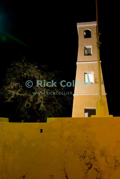 "Kralendijk, Bonaire, Netherland Antilles -- The historic old fort at waterfront in Kralendijk is illuminated at night.   © Rick Collier<br /> <br /> <br /> <br /> <br /> Bonaire; ""Netherlands Antilles""; Caribbean; tropic; tropical; vacation; destination; Kralendijk; night; lights; moon; waterfront; street; ""street scene""; harbor; anchorage; seawall; ""sea wall""; fort; fortress;"