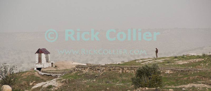 Umm Qais, northwestern Jordan.  A small structure sits atop the remains of the city wall at the biblical town of Gadara (of the Gadarenes).  © Rick Collier<br /> <br /> <br /> <br /> Jordan 'Umm Qais' Ottoman Roman Gadara Gadarenes Bible Biblical ruin ruins 'ancient world' archeology 'archeological site' classical hut landscape