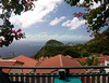 Saba - A scenic view - Roofs of homes below and bougainvillea help frame the view of Saba and the Caribbean from Scout's Place, Windwardside.  © Rick Collier