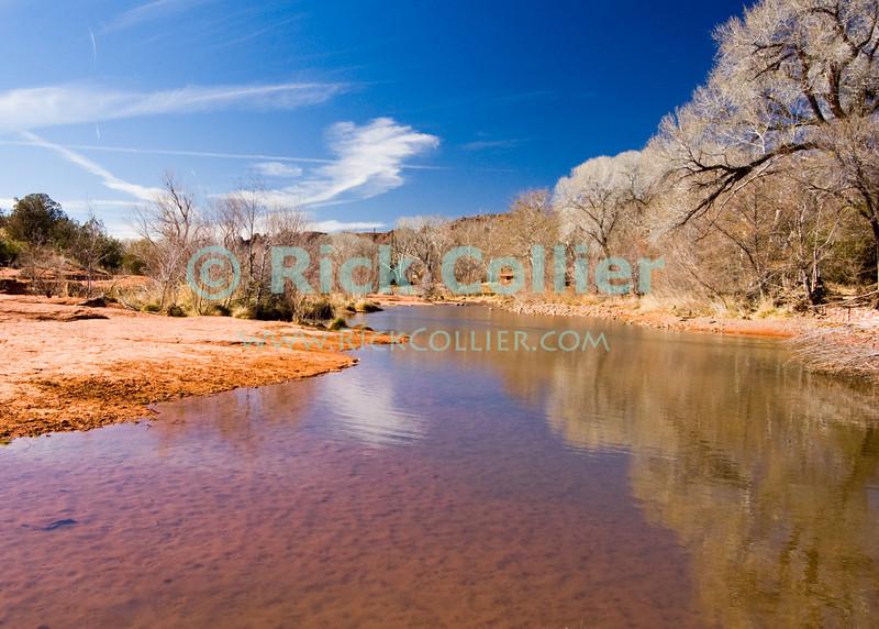 Oak Creek, Sedona, Arizona.  Cottonwood trees frame Oak Creek.  © Rick Collier<br /> <br /> <br /> <br /> <br /> <br /> <br /> <br /> US USA Arizona Sedona Oak Creek water stream river desert cottonwood trees rest calm relax scenic view rocks red sand sandy shore serene