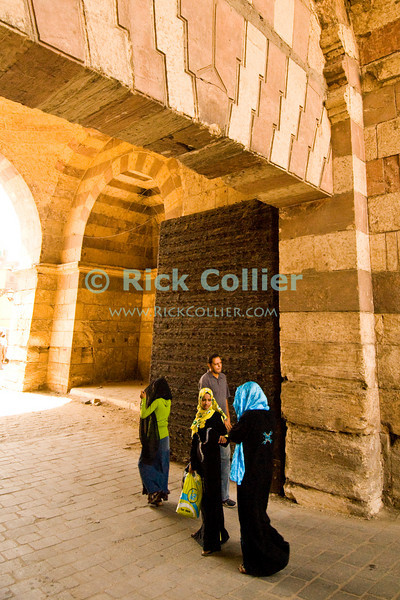 """Cairo, Egypt -- Bab el-Futuh gate.  One of the three first gates installed around the historic walled city of Cairo, standing at the northern boundary of old Fatimid Cairo.   © Rick Collier / RickCollier.com.<br /> <br /> <br /> <br /> <br /> <br /> travel; vacation; tour; tourism; tourist; destination; Egypt; Cairo; city; view; gate; walls; bab; """"Bab el-Futuh""""; Futuh; """"city gate""""; north; """"northern gate"""""""