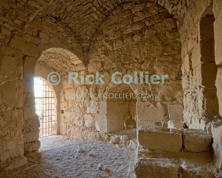 The Crusader Gate was the original secure entrance to Karak Castle.  The Crusader castle at Karak guarded the eastern border of the Kingdom of Jerusalem after the first Crusade. © Rick Collier<br /> <br /> <br /> <br /> <br /> Jordan Karak al-Karak castle crusader crusades knights fort fortress history historic tourist tourism antiquities 'Kingdom of Jerusalem' interior portal gate 'Crusader gate' chamber windows sunlight
