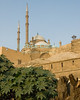 The Citadel of Salah al-Din (Saladin) contains historic mosques and stands tall over the highway in central Cairo, Egypt.  © Rick Collier<br /> <br /> <br /> <br /> <br /> <br /> <br /> Egypt Cairo citadel Saladin minaret spire dome fortification wall fort fortress history historic Islam Islamic Muslim
