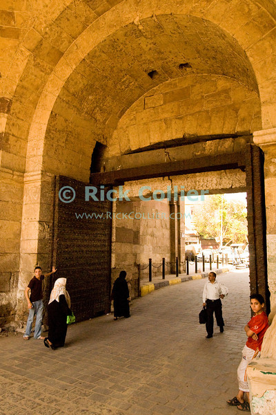"Cairo, Egypt -- Bab el-Futuh gate.  One of the three first gates installed around the historic walled city of Cairo, standing at the northern boundary of old Fatimid Cairo.   © Rick Collier / RickCollier.com.<br /> <br /> <br /> <br /> <br /> <br /> travel; vacation; tour; tourism; tourist; destination; Egypt; Cairo; city; view; gate; walls; bab; ""Bab el-Futuh""; Futuh; ""city gate""; north; ""northern gate"""