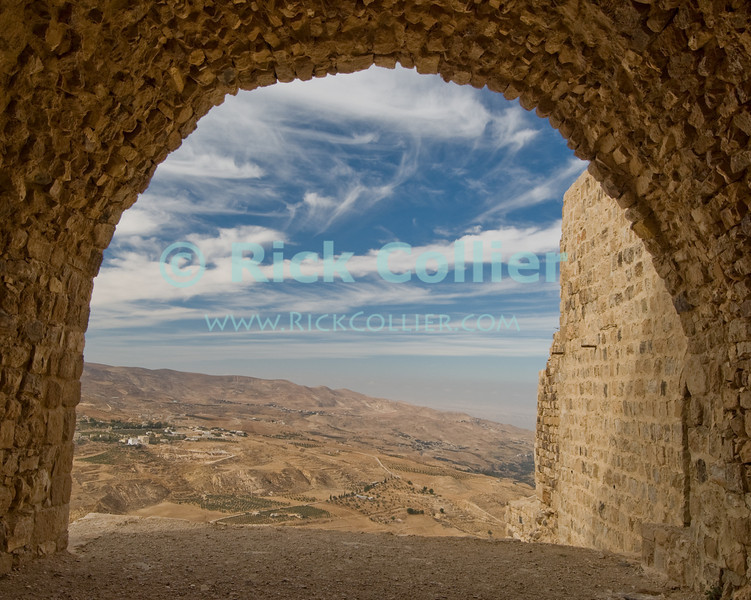 The view towards the dead sea from the stables at Karak Castle.  The Crusader castle at Karak guarded the eastern border of the Kingdom of Jerusalem after the first Crusade. © Rick Collier<br /> <br /> <br /> <br /> <br /> Jordan Karak al-Karak castle crusader crusades knights fort fortress history historic tourist tourism antiquities 'Kingdom of Jerusalem' Bible Biblical view panorama arch archway ruin archeology archeological 'Dead Sea' Galilee Sodom Gomorrah 'Sodom and Gomorrah'