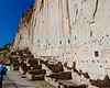 Bandelier National Monument, near Los Alamos and Santa Fe, New Mexico, USA.  Native Americans gradually expanded their cave dwellings by building pueblo structures in front of their cliff-face homes, at the edges of Frijoles Canyon. © Rick Collier<br /> <br /> <br /> <br /> <br /> <br /> <br /> US USA New Mexico Santa Fe Bandelier National Monument Frijoles Canyon cliff cliffs valley canyon native american cave dwelling pueblo view tree trees forest woods stream river