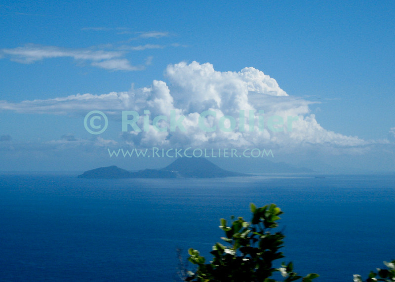 Saba - A scenic view - St. Eustatius from the road on Saba.  (St. Kitts is visible as a shadow behind and to right of Statia.)  © Rick Collier