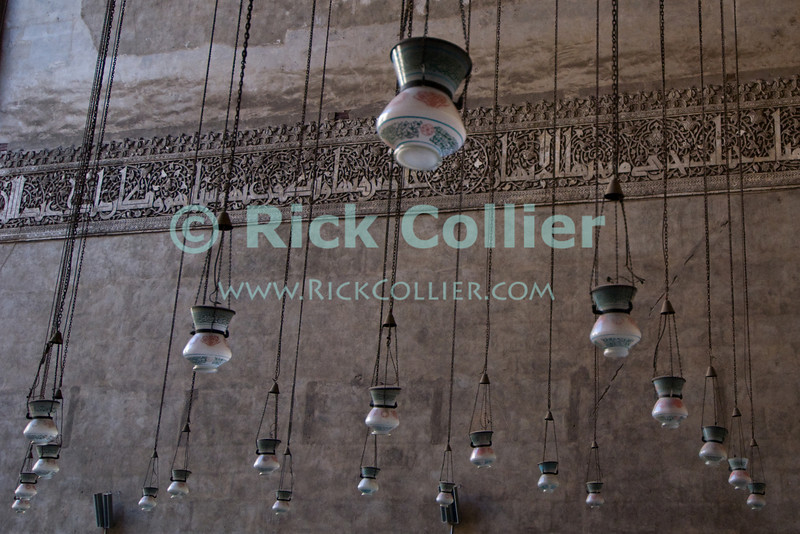 "Cairo, Egypt -- Many lamps illuminate the Sultan Hassan mosque at night. © Rick Collier / RickCollier.com<br /> <br /> <br /> <br /> travel; vacation; tour; tourism; tourist; destination; Egypt; Cairo; mosque; madrassa; Sultan; Hassan; ""Sultan Hassan""; lamp; light; illumination;"