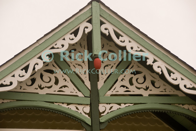 """""""Trimwork"""" - Ornate trimwork is common on the lovely beach houses at Ocean Grove, New Jersey, USA.<br /> <br /> <br /> USA """"New Jersey"""" NJ """"Ocean Grove"""" Ocean Grove building scrollwork trim detail onamentation decoration decor roof peak eve"""