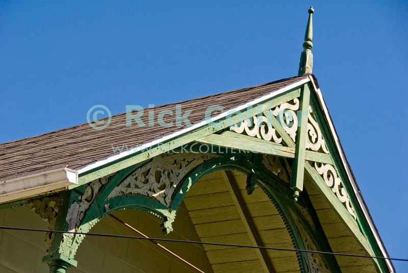 """""""Woodwork"""" - Ornate trimwork is common on the lovely beach houses at Ocean Grove, New Jersey, USA.<br /> <br /> <br /> USA """"New Jersey"""" NJ """"Ocean Grove"""" Ocean Grove building scrollwork trim detail onamentation decoration decor roof peak eve"""