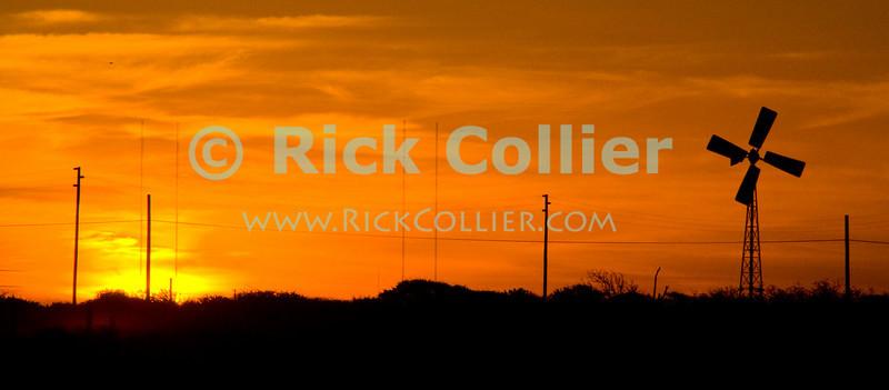 "Bonaire, Netherland Antilles -- A red sky at sunset.   © Rick Collier<br /> <br /> <br /> <br /> <br /> Bonaire; ""Netherlands Antilles""; Caribbean; tropic; tropical; vacation; destination; sunset; ""red sky""; ""orange sky""; windmill; skyline; ""sky line"";"