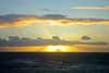 Sunset illuminates the clouds, creating an orange sunset.  Waikiki, Honolulu, Oahu, Hawaii.<br /> <br /> <br /> <br /> <br /> <br /> <br /> Hawaii Hawai'i Waikiki Honolulu sunset clouds sea ocean view
