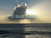 St. Eustatius (Statia) - Sunlight streams from behind a cloud at sunset over the Caribbean.  © Rick Collier