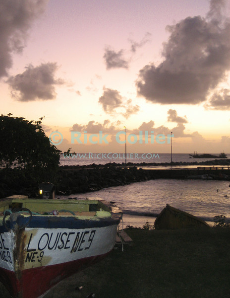 St. Eustatius (Statia) - A fishing boat sits ashore at near the port in a Caribbean sunset.  © Rick Collier