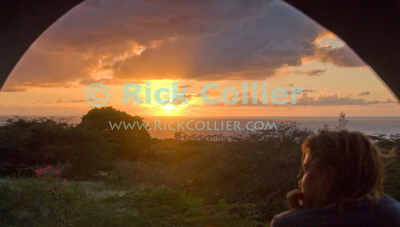 St. Eustatius (Statia) - Nancy enjoys the sunset view at our rented home.  © Rick Collier