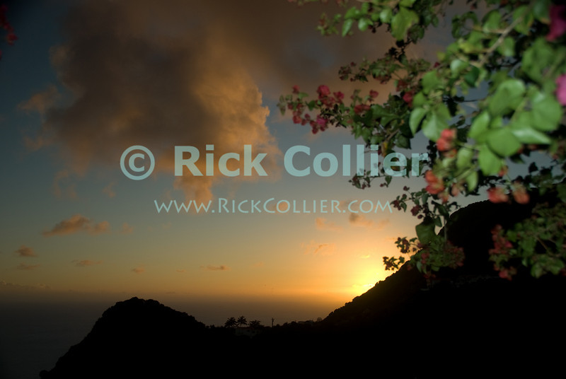 Saba - A scenic view - Bougainvilla flowers frame a beautiful sunset from our room at Scout's Place.  © Rick Collier