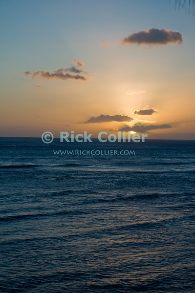 A sunset illuminates the sky off Waikiki, Honolulu, Hawaii.<br /> <br /> <br /> <br /> <br /> Hawaii Honolulu Waikiki sunset sky sea view