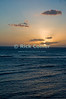 A sunset illuminates the sky off Waikiki, Honolulu, Hawaii.<br /> <br /> <br /> <br /> <br /> Hawaii Honolulu Waikiki sunset sky sea view