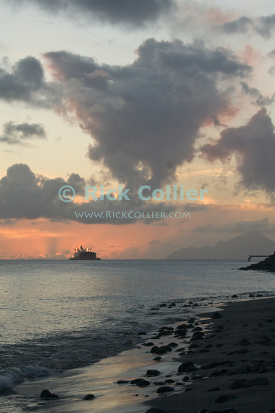 "A beautiful Caribbean sunset silhouettes the beach, with tankers beyond waiting at the oil terminal.  Saba is visible in the distance.  St. Eustatius (Statia), Netherlands Antilles.<br /> <br /> <br /> <br /> <br /> ""St. Eustatius"" ""Saint Eustatius"" Statia Netherlands Antilles ""Lesser Antilles"" Caribbean Saba sunset beach ship tanker clouds sky ocean sea reflection running lights"