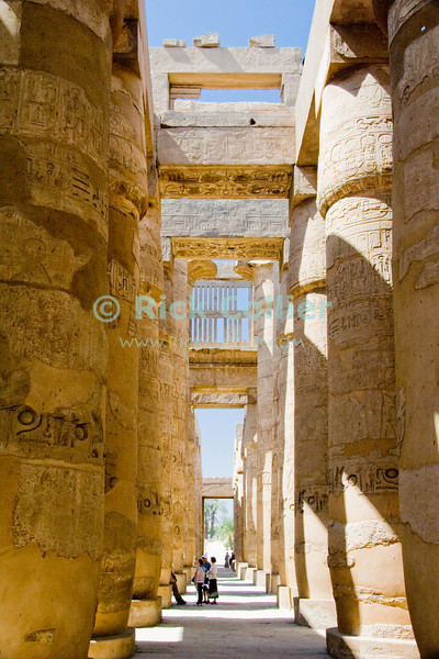 Karnak, outside Luxor, Egypt.  The columns and even parts of the upper windows still stand in the Great Hypostyle Hall, at the great Temple of Amun (or Amon) in Karnak.  The home of Amon (the Sun God), Karnak was the center of Egyptian spiritual life during the middle and late kingdoms.  It was continuously being improved by successive pharoahs over a period of about 1300 years. © Rick Collier<br /> <br /> <br /> <br /> <br /> <br /> <br /> Egypt Egyptian Karnak Amon Amun tourist tourism history historic antiquity antiquities ruins temple tomb pylon wall column pillar ramp ancient 'ancient Egypt' Hypostyle 'hypostyle hall' Thebes Theban Thebian