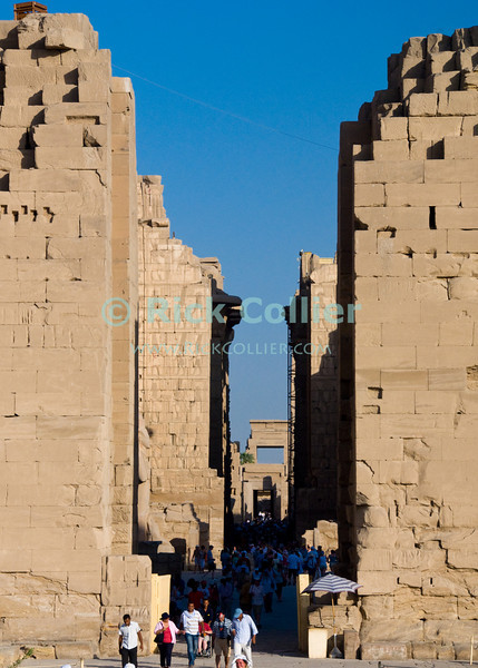 "Luxor, Egypt -- The central pathway from the entrance of Karnak Temple extends through three or more pylons (outer walls), a hypostyle hall, and into the central temple of Amun.  Karnak was built over many generations of Egyptian pharoah, as each successive king added pieces to this temple honoring the most significant god of the ancient Egyptian pantheon, the god Amun (later, Amon-Ra), the sun god. © Rick Collier / RickCollier.com.<br /> <br /> <br /> <br /> <br /> <br /> travel; vacation; tour; tourism; tourist; destination; Egypt; Luxor; Karnak; ""Karnak Temple""; Amun; Amon; Amon-Ra; temple; hieroglyph; hieroglyphic; ""ancient Egypt""; archeology; archeological; ruin; Ramses; pylon; wall"
