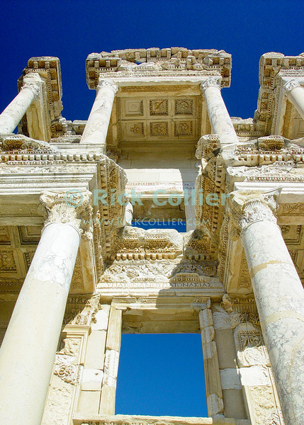 The facade of the Roman Celsus Library still stands at the center of Ephesus, in modern-day Turkey.  The home of the Biblical Ephesians and site where portions of the Book may have been written, the city dates from the Hellenestic (Greek) empire and was subsequently one of the principle cities of the Roman empire.  The city was famed for the Temple of Artemis (Diana), who had her chief shrine there, the Library of Celsus, and its theater, which was capable of holding 25,000 spectators. Ephesus is believed to be the city of the Seven Sleepers. The story of the Seven Sleepers, considered saints by Christians and Muslims, tells that they were persecuted because of their belief in God and that they slept in a cave near Ephesus for centuries.  © Rick Collier<br /> <br /> <br /> <br /> <br /> <br /> <br /> Turkey Ephesus Ephessus Rome Roman Empire Greek Greece Hellenistic Artemis Diana Cayster River Bible Biblical ruin ruins archeology archeological tour tourims tourist view street road column columns temple temples theater amphitheater Celsus Library