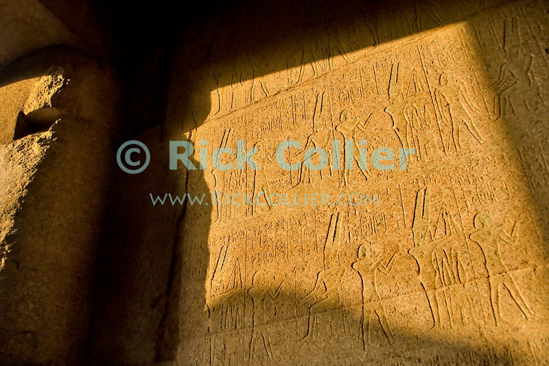 "Luxor, Egypt -- Hieroglyphic inscriptions in the main temple of Amun, in Karnak Temple.  Karnak was built over many generations of Egyptian pharoah, as each successive king added pieces to this temple honoring the most significant god of the ancient Egyptian pantheon, the god Amun (later, Amon-Ra), the sun god. © Rick Collier / RickCollier.com.<br /> <br /> <br /> <br /> <br /> <br /> travel; vacation; tour; tourism; tourist; destination; Egypt; Luxor; Karnak; ""Karnak Temple""; Amun; Amon; Amon-Ra; temple; hieroglyph; hieroglyphic; ""ancient Egypt""; archeology; archeological; ruin; pylon; wall;"