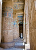 Medinet Habu -- the Mortuary Temple of Ramses III, near Luxor, Egypt.  The enormous pillars of the second court and hypostyle hall still show much of the original coloration and decoration.  Remarkable for its excellent state of preservation and extremely deep heiroglyphic carvings, the original paint and coloration in many parts has been protected by the very deep carvings and solid construction, so still shows in many parts.  The heaviness of construction and depth of carvings was considered a sign of the pharoah's great importance and wealth.  © Rick Collier<br /> <br /> <br /> <br /> <br /> <br /> <br /> Egypt Egyptian Habu 'Medinet Habu' Luxor tourist tourism history historic antiquity antiquities Thebes Theban Thebian Nile 'Nile River' temple tomb monument souvenir shop town village 'Valley of the Kings' necropolis Ramses 'Ramses III' heiroglyph heiroglyphic painting decoration