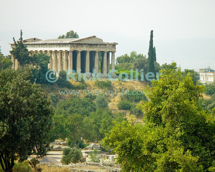 Athens, Greece.  The Temple of Hephaistos rises above the Ancient (Greek) Agora -- the original marketplace of the ancient Greek city-state of Athens.  The Greek god Hephaistos was the god of fire, metalworking, and stonemasonry.  © Rick Collier<br /> <br /> <br /> <br /> <br /> <br /> Greece Athens agora market marketplace ruin runs archaeology archaeological Greek Temple of Hephaistos