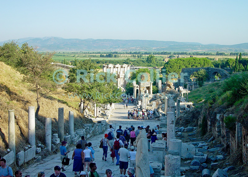 Ephesus, in Turkey.  The ancient pre-Roman city of Ephassus overlooks the flood plain of the Cayster River.  The home of the Biblical Ephesians and site where portions of the Book may have been written, the city dates from the Hellenestic (Greek) empire and was subsequently one of the principle cities of the Roman empire.  The city was famed for the Temple of Artemis (Diana), who had her chief shrine there, the Library of Celsus, and its theater, which was capable of holding 25,000 spectators.   © Rick Collier<br /> <br /> <br /> <br /> <br /> <br /> <br /> Turkey Ephesus Ephessus Rome Roman Empire Greek Greece Hellenistic Artemis Diana Cayster River Bible Biblical ruin ruins archeology archeological tour tourims tourist view street road column columns temple temples theater amphitheater library
