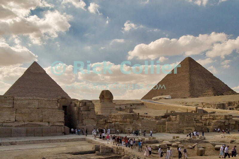 """Giza, Cairo, Egypt -- Viewed from the side, the Great Sphinx and the funerary temple of Khafre (Kephren), sit in the foreground with Khafre's pyramid (on the left) and the """"Great Pyramid"""" of Khufu (Cheops, on right) in the background. © Rick Collier / RickCollier.com<br /> <br /> <br /> <br /> <br /> <br /> travel; vacation; destination; Egypt; Cairo; Giza; pyramids; pyramid; """"Pyramids at Giza""""; tourist; tourism; Khafre; Kephren; sphinx; """"Great Sphinx""""; """"Great Pyramid""""; Khufu; Cheops"""