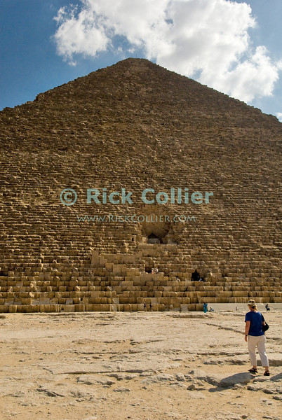 "Giza, Cairo, Egypt -- Tourists approach the entrances where for a small fee, you can go inside the Great Pyramid of Khufu (Cheops) at Giza. © Rick Collier / RickCollier.com<br /> <br /> <br /> <br /> <br /> <br /> travel; vacation; destination; Egypt; Cairo; Giza; pyramids; pyramid; ""Pyramids at Giza""; Cheops; Khufu;"