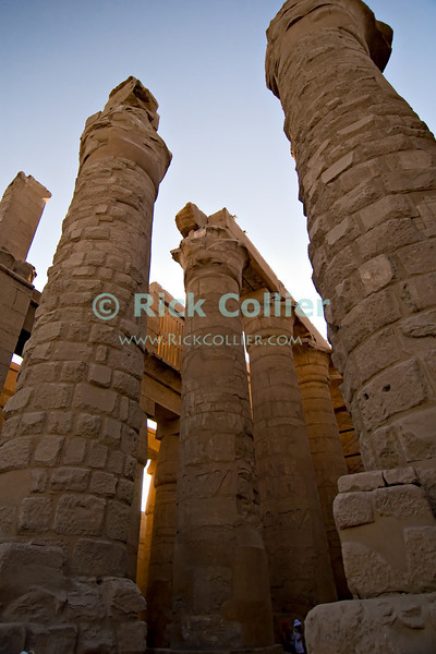 """Luxor, Egypt -- The great hypostyle hall in Karnak Temple.  Karnak was built over many generations of Egyptian pharoah, as each successive king added pieces to this temple honoring the most significant god of the ancient Egyptian pantheon, the god Amun (later, Amon-Ra), the sun god. © Rick Collier / RickCollier.com.<br /> <br /> <br /> <br /> <br /> <br /> travel; vacation; tour; tourism; tourist; destination; Egypt; Luxor; Karnak; """"Karnak Temple""""; Amun; Amon; Amon-Ra; temple; hieroglyph; hieroglyphic; """"ancient Egypt""""; archeology; archeological; ruin; pylon; wall; column; pillar; """"hypostyle hall"""""""