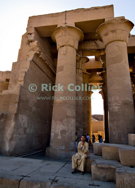 """Kom Ombo, Egypt -- The unique ancient Egyptian temple at Kom Ombo was built during the Ptolemaic period and was unique in that it was divided symmetrically between two gods along an East-West axis.  The north half was dedicated to the falcon god Haroeris (Horus the Elder, a form of the more common Horus) and the south to Sobek, the crocodile god of fertility. © Rick Collier / RickCollier.com.<br /> <br /> <br /> <br /> travel; vacation; tour; tourism; tourist; destination; Egypt; """"Kom Ombo""""; temple; """"Kom Ombo Temple""""; Horus; Haroeris; Sobek; hieroglyphs; hieroglyphics; carvings; art; columns; column; relief; """"ancient Egypt""""; pharoah; pharonic; Ptolemy; Ptolemaic;"""
