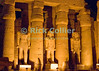 Statues of pharoah alternate with columns in the Court of Ramses II at Luxor Temple, Egypt.  The lights come on at nightfall, adding drama to the passages and courtyard within the temple.  Dedicated to the Theban triad of Amun-Min, Mut, and Konsu, Luxor Temple stands in the center of town and is illuminated every night.  © Rick Collier<br /> <br /> <br /> <br /> <br /> <br /> <br /> Egypt Egyptian Karnak Luxor Amon Amun tourist tourism history historic antiquity antiquities ruins temple tomb pylon wall column pillar ramp ancient 'ancient Egypt' Thebes Theban Thebian Mut Konsu Amun-Min Khonsu obelisk pylon wall Ramses 'Ramses II' statue colossus colossi night illumination lights dark 'after dark' nighttime