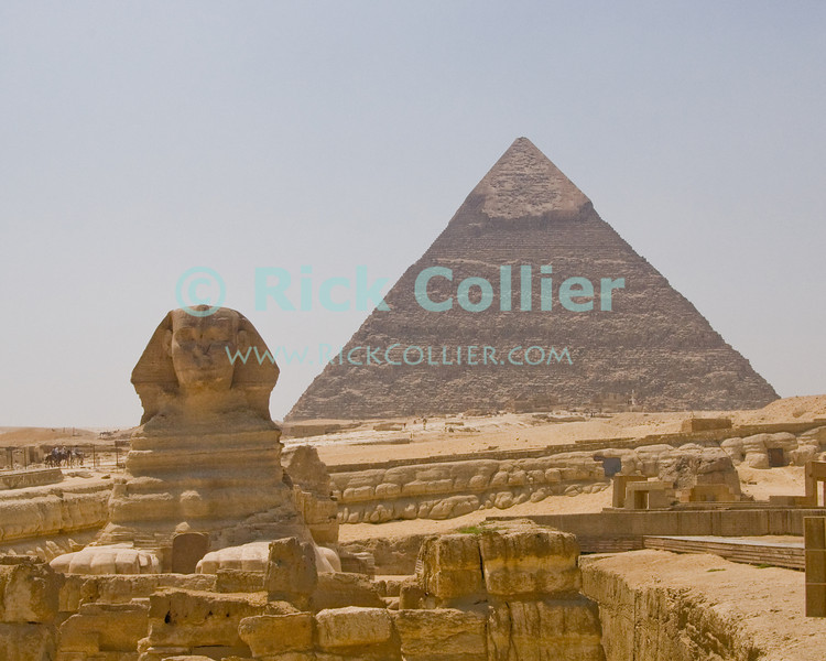 The Sphinx and remains of the valley temples stand before the Pyramid of Chephren, to which they are linked by a causeway (visible to the left of the Sphinx).  Giza, outside Cairo, Egypt.  © Rick Collier<br /> <br /> <br /> <br /> <br /> <br /> <br /> Egypt Egyptian Cairo Giza pyramid pyramids Sphinx Cheops Mycerinus Chephren temple 'valley temple' 'Great Pyramid' 'Great Pyramid of Cheops' Chephren 'Pyramid of Chephren' Mycerinus 'Pyramid of Mycerinus' queen queens 'Queen's Pyramids' 'Queens Pyramids' tourist tourism history historic antiquities 'ancient Egypt' ancient antiquity tomb tombs
