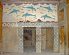The Palace of Knossos, on Crete, Greece.  The remains of colorful frescoes have been uncovered in the remains of the Palace at Knossos.  This frescoe was probably inside the palace baths.  Probably the ceremonial and political center of the Minoan civilization, the bronze-age palace at Knossos has been partially reconstructed.  © Rick Collier<br /> <br /> <br /> <br /> <br /> <br /> Greece Crete Knossos Minoa Minoan palace fort ruin ruins tourist tourism tourists tour reconstruction history historic archaeology archaeological stair stairways stairs staircase staircases door doors window windows fresco frescoes dolphin dolphins fish bath baths
