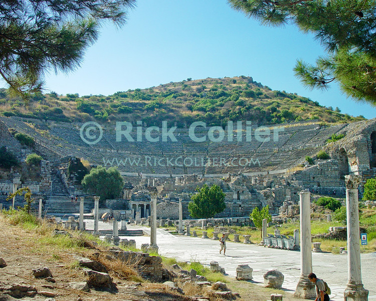 Ephesus, in Turkey.  The Roman theater in ancient Ephassus overlooks the flood plain of the Cayster River.  The home of the Biblical Ephesians and site where portions of the Book may have been written, the city dates from the Hellenestic (Greek) empire and was subsequently one of the principle cities of the Roman empire.  The city was famed for the Temple of Artemis (Diana), who had her chief shrine there, the Library of Celsus, and its theater, which was capable of holding 25,000 spectators.   © Rick Collier<br /> <br /> <br /> <br /> <br /> <br /> <br /> Turkey Ephesus Ephessus Rome Roman Empire Greek Greece Hellenistic Artemis Diana Cayster River Bible Biblical ruin ruins archeology archeological tour tourims tourist view street road column columns temple temples theater amphitheater library