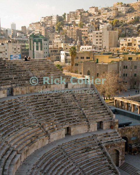 At the Theater.  Two women chat, seated at the top row of the Roman theater in the oldest, Islamic section of Amman, Jordan.  What is now Amman was once the city known in the classical world as Roman Philadelphia.  © Rick Collier<br /> <br /> <br /> <br /> <br /> <br /> <br /> Jordan Amman Rome 'Roman Empire' 'Roman Philadelphia' ancient antiquity tourism tourist 'Roman forum' city Islamic buildings apartments 'city center' history historic classic classical