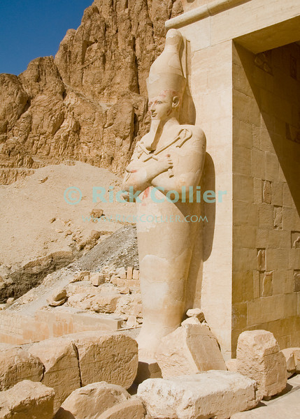 Deir el-Bahri (Temple of Hatshepsut), near Luxor, Egypt.  A statue of Hatshepsut, as a male Pharoah.  This like all statues found at this site, this has been reconstructed from pieces of the original, which still show traces of the original coloring.  Hatshepsut was scourged by her successors, as the only woman who ever had the temerity to rule Egypt as a man (pharoah).  © Rick Collier<br /> <br /> <br /> <br /> <br /> <br /> <br /> Egypt Egyptian Karnak Luxor tourist tourism history historic antiquity antiquities Thebes Theban Thebian Nile 'Nile River' temple tomb monument Hatshepsut pharoah 'Deir el-Bahri' statue