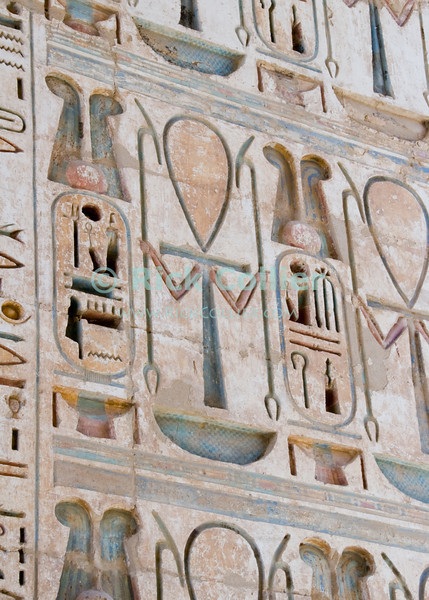 Medinet Habu -- the Mortuary Temple of Ramses III, near Luxor, Egypt.  The ankh was the sign of life and power, reflected in the very deep carvings in this wall inscribed to the eternal health and life of the pharoah as he passes through these walls on his way to the underworld.  Remarkable for its excellent state of preservation and extremely deep heiroglyphic carvings, the original paint and coloration in many parts has been protected by the very deep carvings and solid construction, so still shows in many parts.  The heaviness of construction and depth of carvings was considered a sign of the pharoah's great importance and wealth.  © Rick Collier<br /> <br /> <br /> <br /> <br /> <br /> <br /> Egypt Egyptian Habu 'Medinet Habu' Luxor tourist tourism history historic antiquity antiquities Thebes Theban Thebian Nile 'Nile River' temple tomb monument souvenir shop town village 'Valley of the Kings' necropolis Ramses 'Ramses III' heiroglyph heiroglyphic painting decoration anhk cartouche