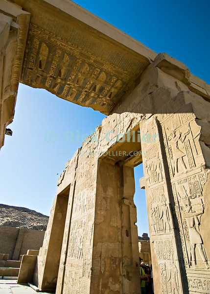"Kom Ombo, Egypt -- The unique ancient Egyptian temple at Kom Ombo was built during the Ptolemaic period and was unique in that it was divided symmetrically between two gods along an East-West axis.  The north half was dedicated to the falcon god Haroeris (Horus the Elder, a form of the more common Horus) and the south to Sobek, the crocodile god of fertility. © Rick Collier / RickCollier.com.<br /> <br /> <br /> <br /> travel; vacation; tour; tourism; tourist; destination; Egypt; ""Kom Ombo""; temple; ""Kom Ombo Temple""; Horus; Haroeris; Sobek; hieroglyphs; hieroglyphics; carvings; art; columns; column; relief; ""ancient Egypt""; pharoah; pharonic; Ptolemy; Ptolemaic;"