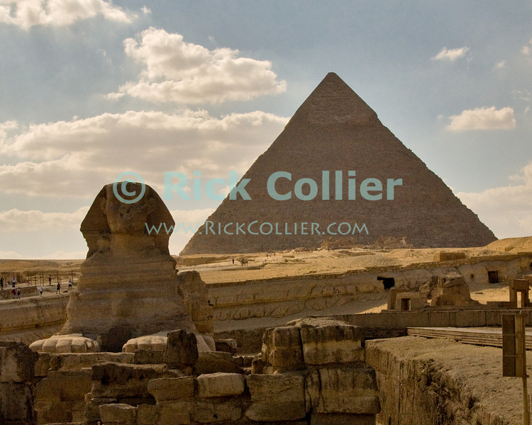 """Giza, Cairo, Egypt -- The Great Sphinx, part of the funerary temple of Khafre (Kephren), sits in front of the processional causeway that leads to Khafre's pyramid, in the background. © Rick Collier / RickCollier.com<br /> <br /> <br /> <br /> <br /> <br /> travel; vacation; destination; Egypt; Cairo; Giza; pyramids; pyramid; """"Pyramids at Giza""""; tourist; tourism; Khafre; Kephren; sphinx; """"Great Sphinx"""""""