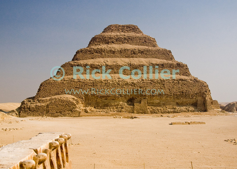Saqqara, Egypt -- Zoser's Step Pyramid stands at the end of the open courtyard at the center of Zoser's funerary complex in Saqqara.  The famous 'Step Pyramid of Zoser (or Djoser, or Doser) is among the oldest pyramids in Egypt, was designed and built by Imhotep, who was the pharoe's architect.  The 'step pyramid' style predates the more famous smooth-sided pyramids found in Giza. © Rick Collier<br /> <br /> <br /> <br /> <br /> <br /> <br /> Egypt Egyptian Cairo Saqqara pyramid pyramids step steps pharoah pharoahs Zoser Dozer Doser Djoser 'step pyramid' Imhotep tourist tourism history historic antiquities 'ancient Egypt' ancient antiquity audience tomb tombs